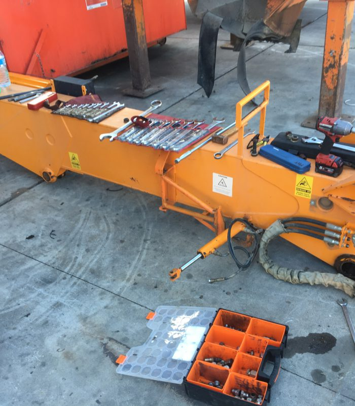 A photo of part of a diesel crane arm with tools